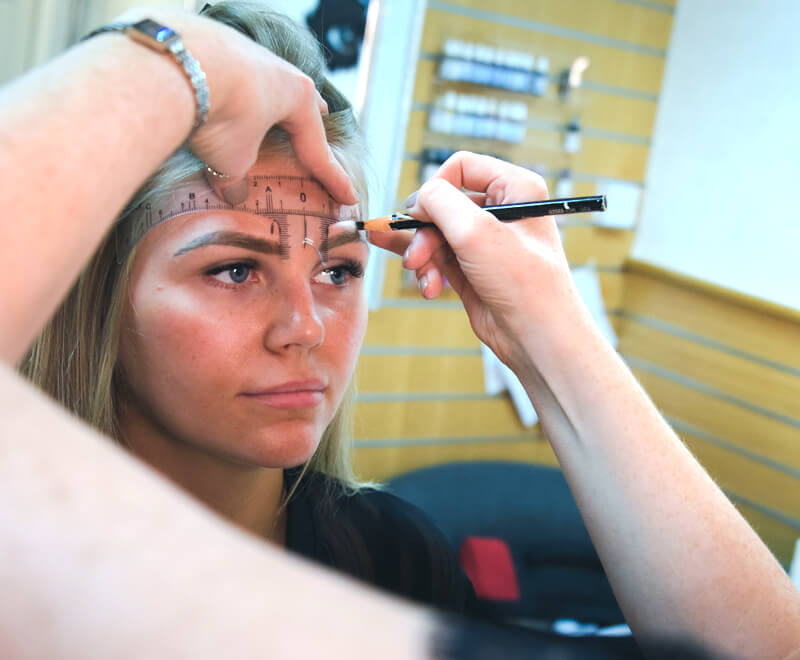 Micropigmentation Course - Clients is having her forehead and eyebrow space measured, ready for treatment